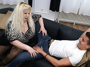 Huge breasted housewife fucking her toy boy