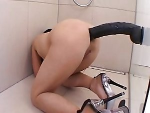 Gigantic dildo in the ass
